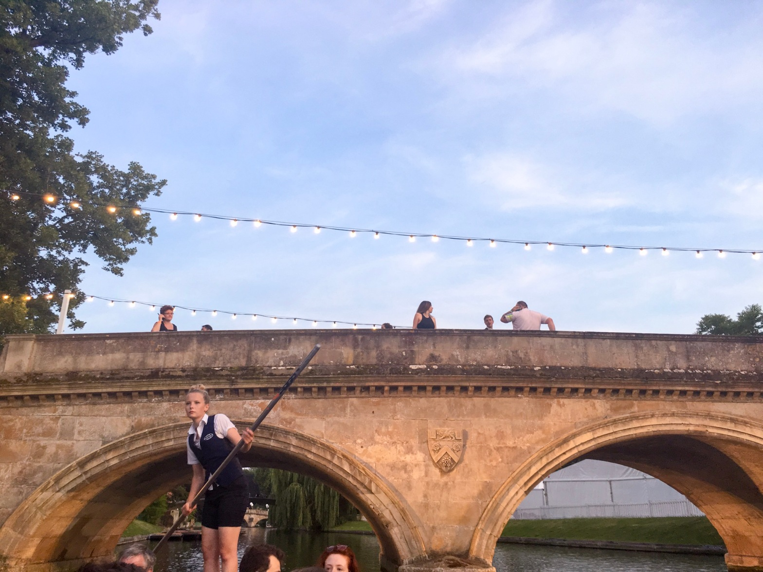 Punting and fairy lights over a beautiful bridge, Cambridge