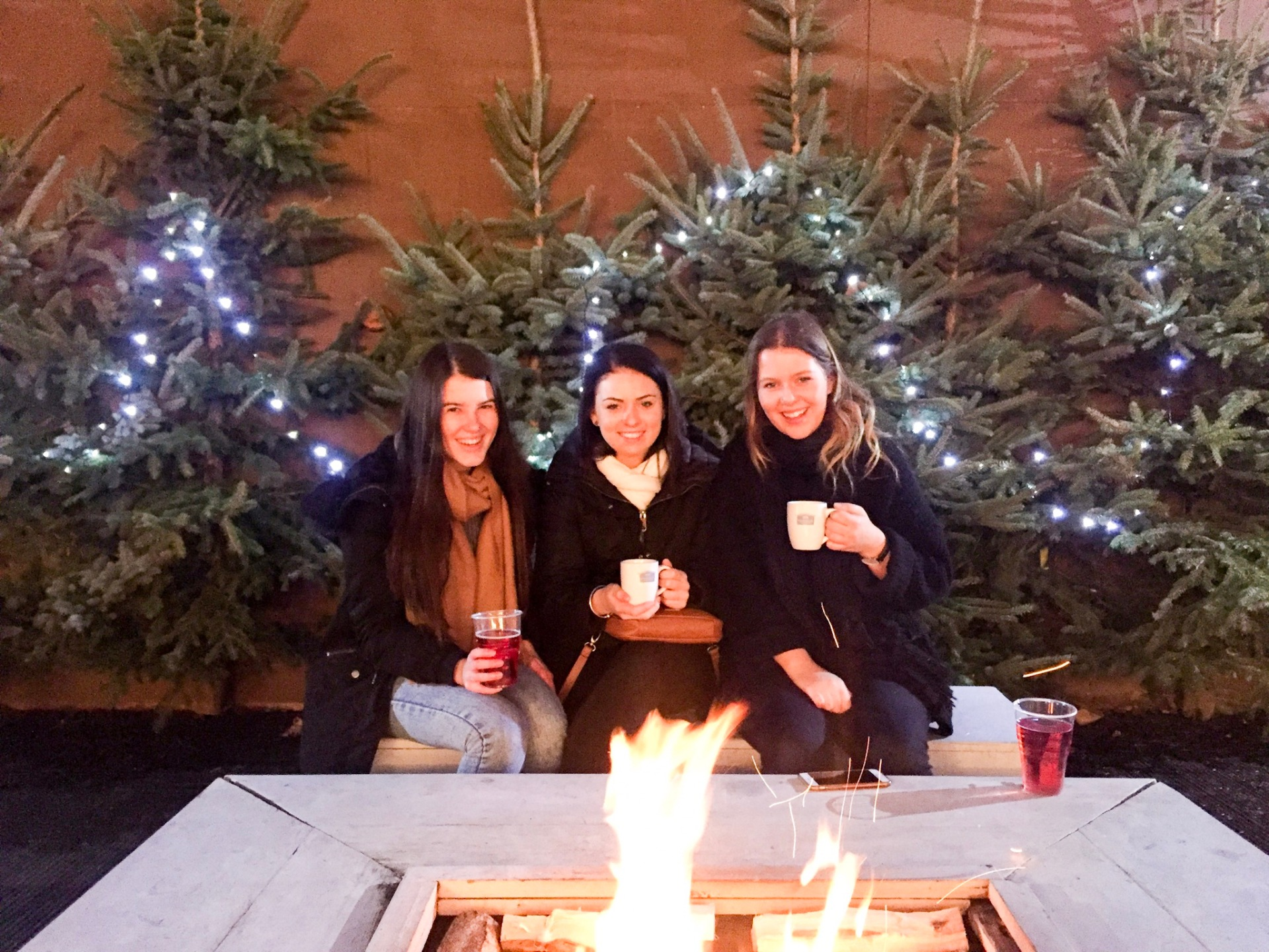 Drinking mulled wine in front of a fire