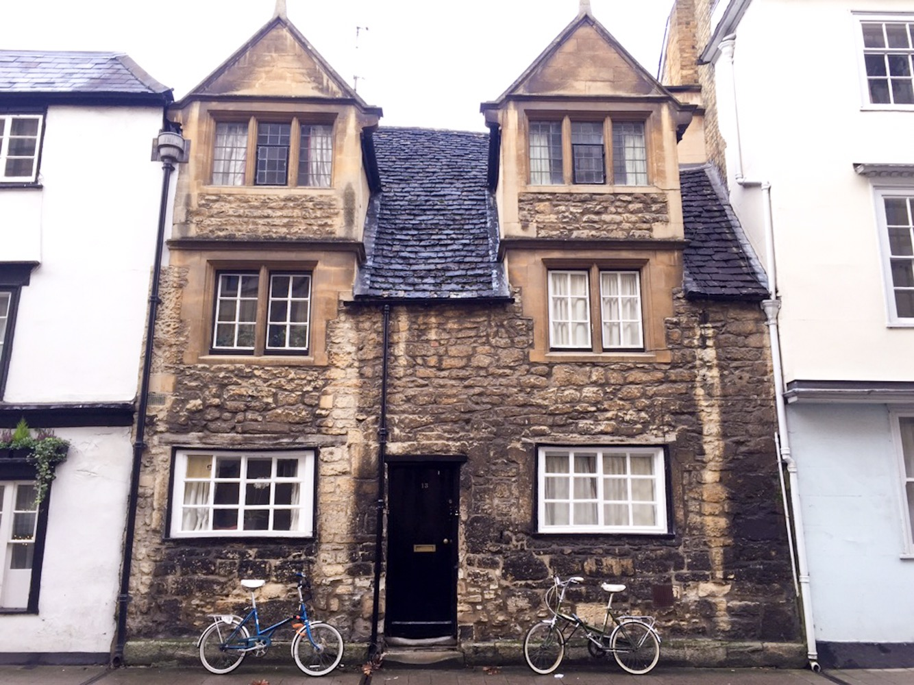 Bikes in front of an old stone house, Oxford