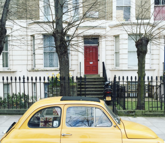 Yellow car and red door in Notting Hill, London