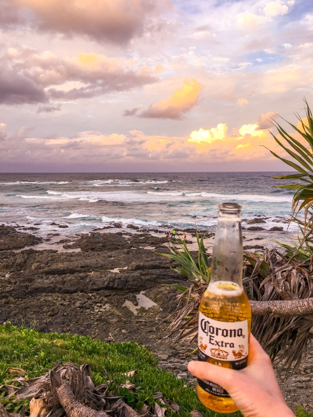 Pink skies sunset over Cabarita with a beer
