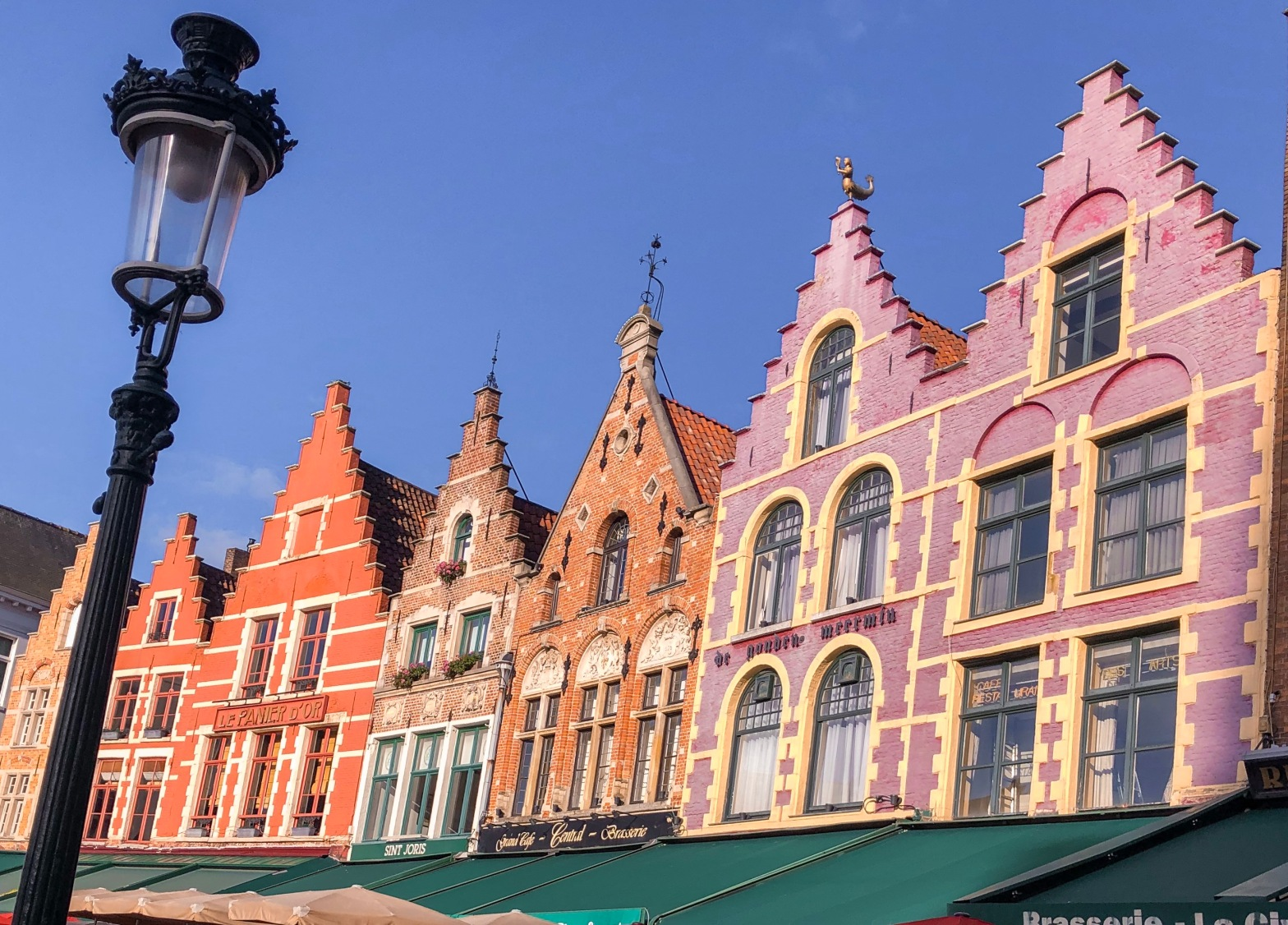 Colourful buildings on the main market square of Bruges. They look like gingerbread houses.